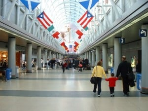 family in airport, family travel, carry-on luggage