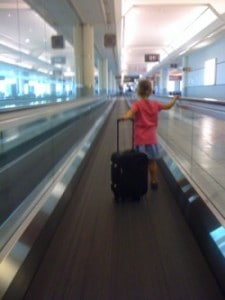 child at airport, flying with kids, travel with children, family travel