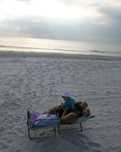 flying with baby, flying with an infant, family on beach, enjoying madeira beach, madeira beach florida, florida