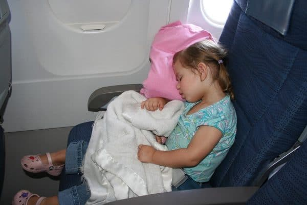 toddler sleep on a plane, toddler sleep on plane, flying with a toddler, flying with toddlers