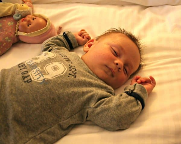 Traveling with a Newborn Sleeping on Hotel Bed